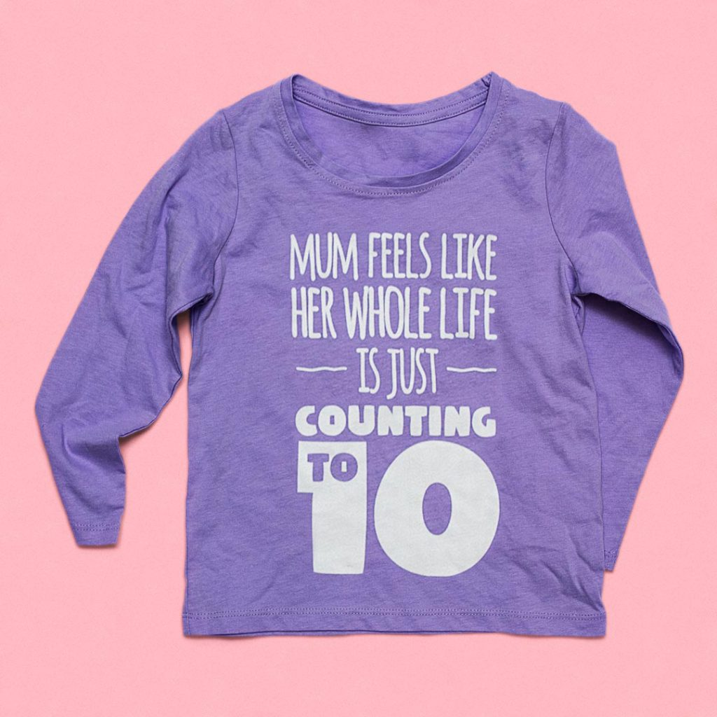 Infant's clothing with 'Mum feels like her whole life is just counting to 10' printed on it