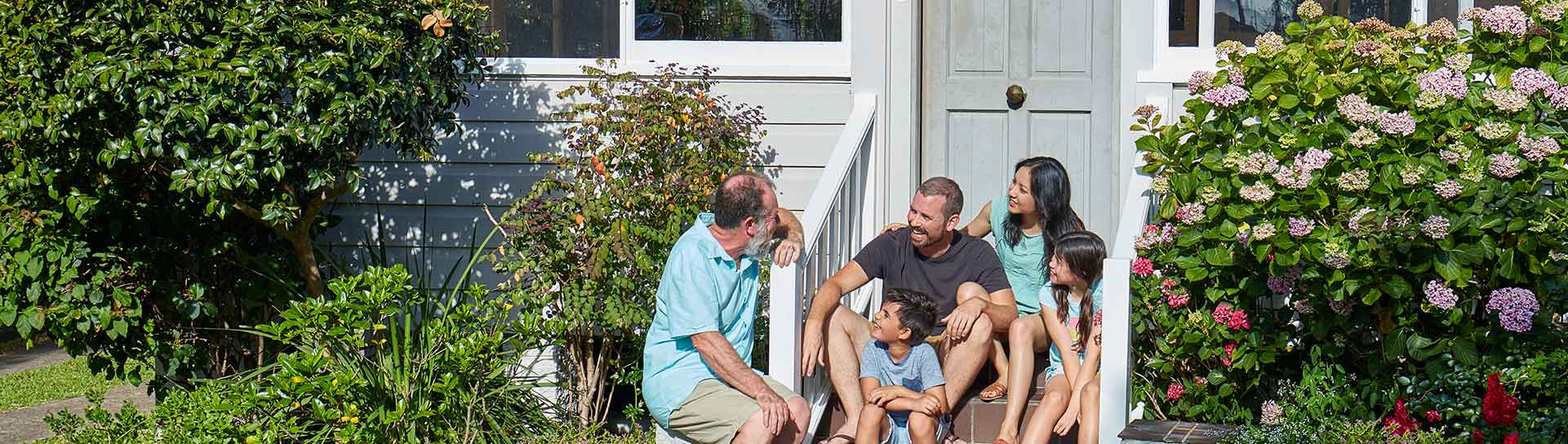 A family chatting on their front steps
