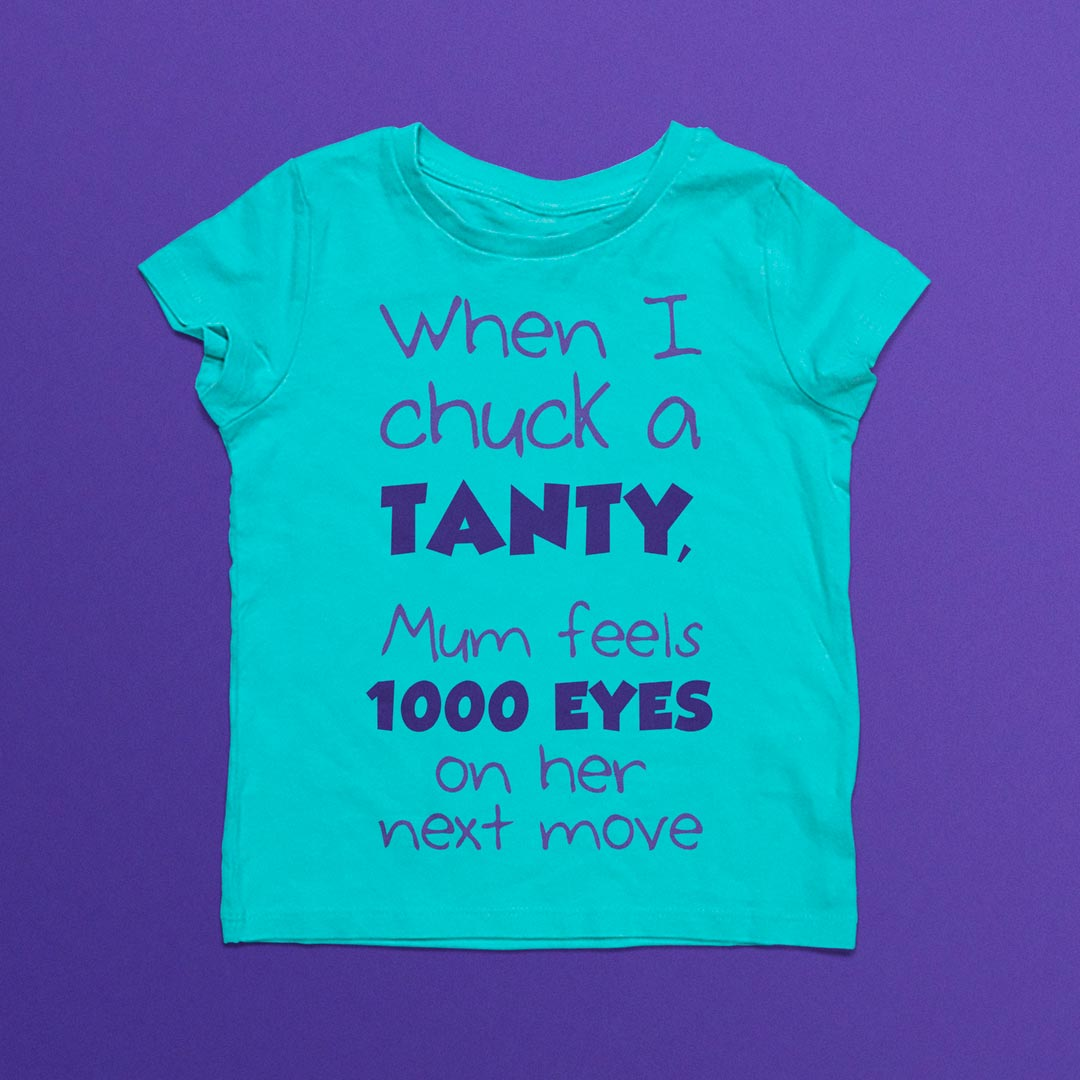 Infant's clothing with 'When I check a tanty, Mum feels 1000 eyes on her next move' printed on it