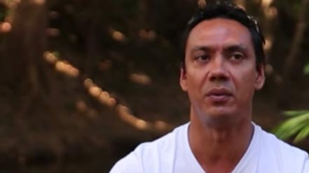 Screenshot of a man from a video