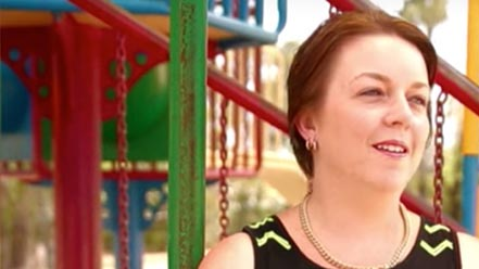 Screenshot of a woman from a video